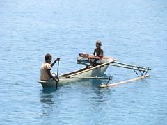 2 children in an outrigger canoe (kahunapulej) Tags: ocean boy girl children boat canoe png skip papuanewguinea province outrigger madang niugini kahunapulej kahunapule