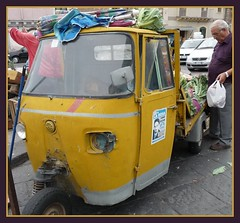 going to the market (Jen's Stream) Tags: italy man broken lamp car yellow market vegetable wanted groceries mafia larosa brokenlamp worldtrekker gettyvacation2012
