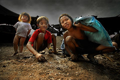 Children of Ulingan (Charcoal Factory), Manila - Young Charcoal Kids,  Pic #9 (Mio Cade) Tags: boy portrait black hot monochrome work book justice kid child labor smoke poor social dirty dirt burn charcoal rights manila labour coal volunteer childlabor tondo earthasia ulingan philipplines