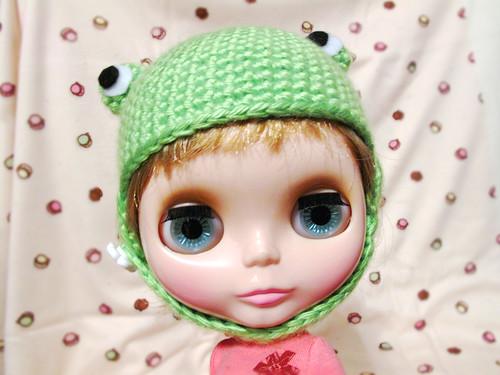 Isobel Creampuff models her frog hat.