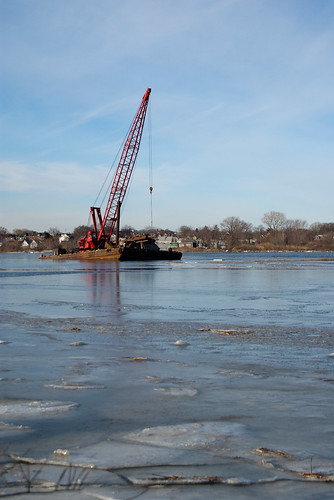 Floating crane frozen in ice