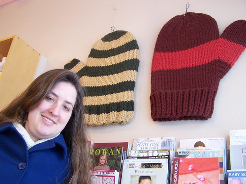 Giant mittens on the wall at Knitwit with my head for scale(?!)