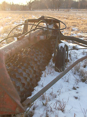 ([holly].) Tags: sunset snow field metal machine plow
