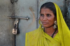 Woman in front of her house (Asia - India) (RURO photography) Tags: voyage travel portrait people india beautiful smile face female canon fun photography reisen asia faces photos culture reis bijoux portraiture lonelyplanet jewels ethnic portret indi anthropology arquitecture gujarat reise inde independant cultuur reizen discoverychannel azi juwelen olddoors gesichter supershot kartpostal nationalgeography enstantane indigenoustribal voyageursdumonde naturalbeautyportraiture tourisism globalbackpackers discoveryphoto discoveryexpeditions rudiroels thegalleryoffineportrait fadingcultures ethnograaf ethnografisch culturasperdidas verdwenenculturen