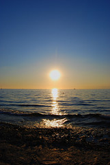 Izola (Sareni) Tags: sunset sea summer sky sun beach colors reflections evening boat nikon waves ship july explore more slovenia slovenija swimmers 2009 adriatic isola jadran twop izola d60 nikond60 jadranskomore savebeautifulearth sareni
