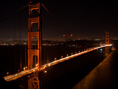 The Gates from Marin (jayRaz) Tags: ocean sanfrancisco road longexposure light sea orange reflection cars water night highway nightlights sfo goldengatebridge freeway sanfranciscobay suspensionbridge marinheadlands inthedistance pacificiocean