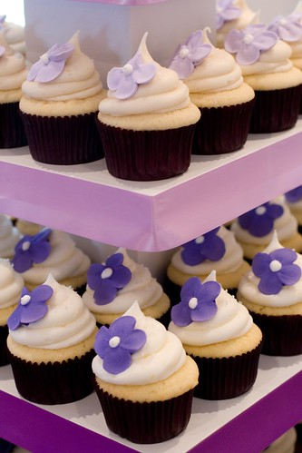 Purple flower and white wedding cupcakes by Cupcake Chic