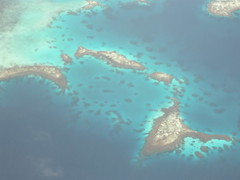 Flying over Chuuk, Micronesia (mattk1979) Tags: ocean above sky coral clouds plane island islands pacific turquoise flight wing aerial atoll weno chuuk federatedstatesofmicronesia truklagoon continentalairmicronesia