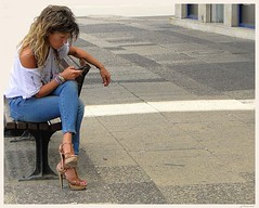 Girls of Israel 2 (jackfre2 (on a trip-voyage-reis-reise)) Tags: girls beautiful bench israel sitting highheels cellular date bluejeans phoning dialing dblringexcellence blendedraces