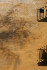Neighborhood (sonofsteppe) Tags: street old shadow urban brown black detail building tree art texture vertical wall cord 50mm mural hungary exterior outdoor balcony budapest nobody rope surface neighborhood explore environment weathered aged ochre exploration thewall ilmuro wallscape sonofsteppe pusztafia zugl urbanlifeoftrees
