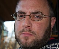 January (Remiss63) Tags: portrait copyright selfportrait color digital beard glasses sweater nikon photographer january knit cotton porch utata 2009 allrightsreserved raimist d90 andrewraimist remiss63 january2009