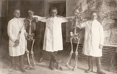 Posing with skeletons (Hannhell) Tags: men vintage death blackwhite boots grim posing 100v10f medical skeletons oldphotograph foundphotograph whitejacket forgottenpeople views2000 50fave