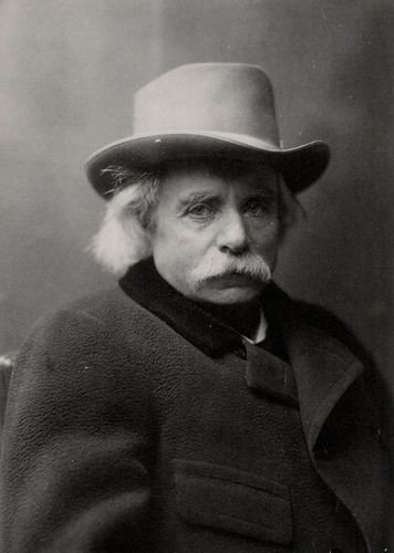 [Edvard Grieg with hat and coat]