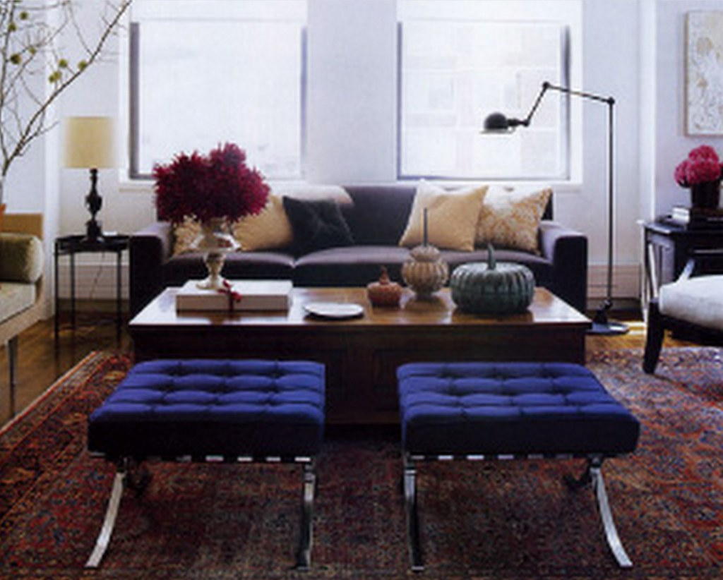 Modern-traditional mix: Persian carpet + Knoll Barcelona stools, from Elle Decor