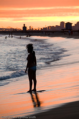 Sunset and Silhouette in Seal Beach (csmith01964) Tags: ocean california sunset summer sky orange beach water silhouette yellow nikon pacificocean bikini southerncalifornia orangecounty endlesssummer lightroom sealbeach d300 colorfulclouds beautifulimage girlonbeach flickraward intensesunset grouptripod cynthiasmithphotography