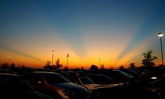 Parking Lot Sunset (tim.perdue) Tags: blue light columbus sunset ohio red sky orange sun cars interestingness twilight suburban dusk parking lot rays polaris utatafeature friendlychallenges
