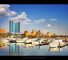 kuwait marina revisited - a different perspective [HDR] (alvin lamucho ) Tags: morning blue yellow clouds marina reflections boats gold gulf bright middleeast palm starbucks shoppingmall kuwait yachts skyblue fahaheel speedboats canon450d canonrebelxsi alvinlamucho