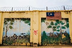 paradise prison (ion-bogdan dumitrescu) Tags: wall wire paradise flag prison malaysia kualalumpur malay bitzi summer09 mg9780 ibdp findgetty ibdpro wwwibdpro ionbogdandumitrescuphotography
