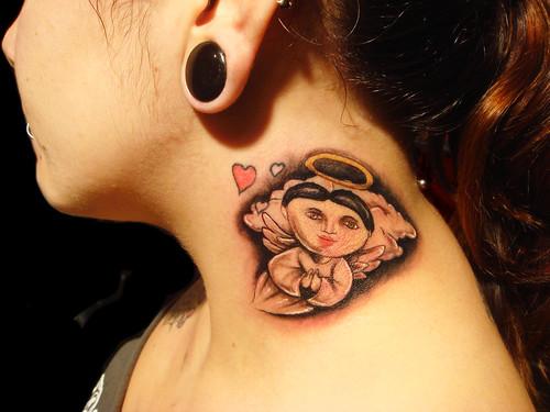 Tattoo is heart at jugular woman