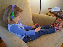 Rachel watching Harry Potter on our family iPod Touch
