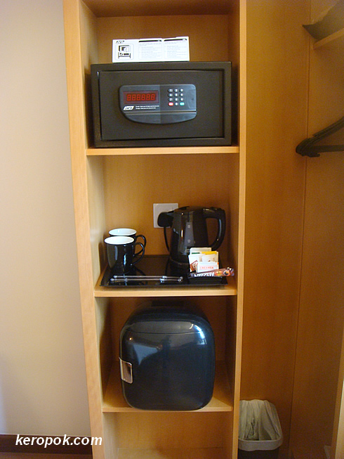 The coffee maker, fridge and safe.