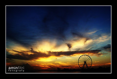 Eye on Malaysia... (alif  mim  ya  nun) Tags: world travel sunset sky cloud sunlight travelling eye tourism beautiful wheel silhouette dawn asia ferris glorious precious malaysia favourites around fav raya moment truly across amin cuti sillhouette melaka uprising malacca fitri matahari fotografy sunlite abigfave platinumphoto terbenam flickrdiamond theunforgettablepictures melancong silwek godbeauty