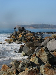 On The Rocks (Enlarge) (thrown_art (off + on for a bit)) Tags: ocean california fish man beach swim island climb fisherman sand rocks sandiego tide boulders pacificocean breakers tackle bait undertow fishingrod waver angler rocksandwater coronadohotel crashingrocks delcoronadoisland