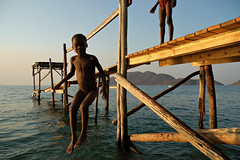 Boy jumping  into Lake Malawi from a pier for boats - Cape Maclear (PascalBo) Tags: africa boy people outdoors kid nikon child d70 malawi enfant lakemalawi garçon afrique southernafrica eastafrica lakenyasa lakeniassa capemaclear 123faves lakenyassa afriqueaustrale afriquedelest lacmalawi pascalboegli lacnyasa lacnyassa lacniassa lplakes
