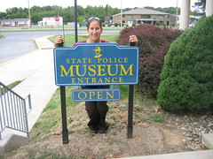 Beth at the Delaware State Police Museum Sign