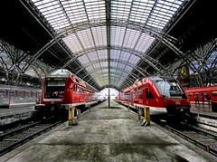 The Gestalt of Coming and Going (Stuck in Customs) Tags: red urban panorama beautiful lines station architecture composition train germany dark fun photography dresden amazing movement nikon energy europe shoot industrial photographer shot angle image details d2x perspective picture surreal railway trains symmetry leipzig collection hauptbahnhof trainstation edge transit processing stunning pro arrival framing top100 portfolio lovely coming capture drama emotions hbf 2009 halle dynamism hdr tutorial treatment lucisart lucis stuckincustoms treyratcliff lucisart6 lucistutorial