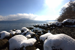 Shikotsu Ko in Winter (.mushi_king) Tags: winter mountain lake holiday snow cold ice beach japan volcano rocks hokkaido north freezing ko nippon shikotsu