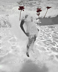 (lindilindi) Tags: flowers red blackandwhite bw woman white water pool girl female ga underwater dress hawaiimelindapodorlindilindicopyrightdonotusewithoutpermission gettyinvited