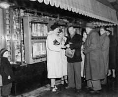 02-10-1951_09024 Geldwisselaar (IISG) Tags: money male men amsterdam female women smoking geld vrouwen roken mannen sigaren sigaretten automaat benvanmeerendonk