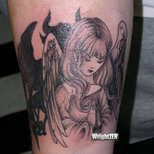 cartoon devil tattoos. Angel Devil Tattoo