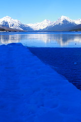 IMG_7695 copy (grafficartistg4) Tags: camera blue winter light sun sunlight mountain lake snow mountains cold reflection slr ice nature water beauty digital photography eos frozen montana freezing h2o freeze glaciernationalpark icy gnp canon30d lakemcdonald nwmontana photophotograph