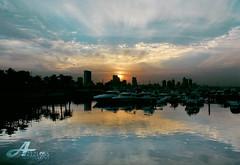 La Nascita e La Morte (ZiZLoSs) Tags: sunset sea sky reflection marina canon mall landscape eos la morte e kuwait 1855mm nascita aziz abdulaziz  450d zizloss  3aziz almanie photoziz