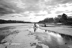 (Alieh) Tags: snow water persian cyclist iran persia iranian  esfahan isfahan    zayandehrood aliehs alieh       saadatpour snowypeopleproject