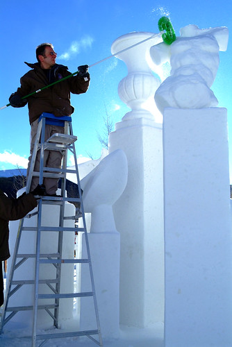 A sculptor carving at the Breckenridge, CO International Snow Sculpture Championships. Image by Jeff Scroggins.winter breckenridge colorado adler
