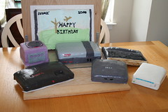 Video Game console cakes in front of