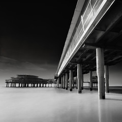 Scheveningen Pier - Square IX (Joel Tjintjelaar) Tags: photography passion f22 blackwhitephotos squarecropping silverefexpro walkingonthepier tjintjelaar obramaestra longsandybeachs thescheveningenpierexposed blackandwhitelongexposurewithabw110nd301000xneutraldensityfilter seasideresortthehague tamron1024uwaultrawideangle