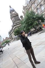 Dan Meth brushes his teeth in Victoria Gardens in front of Leeds Town Hall (Irish Wonderboy) Tags: newyork illustration leeds cartoons nti oldbroadcastinghouse danmeth