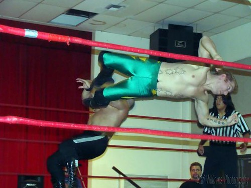 Dingo connects with a dropkick early on to daze Tony Kozina. Photo by Kari Williams