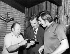 Actor Mickey Rooney showing men his key to the...