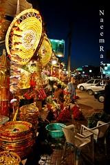 Flower Shop, Lahore (Naeem Rashid) Tags: street flowers pakistan flower d50 evening nikon streetphotography punjab lahore flowershop gulberg libertymarket 18200vr lahoreexclusively