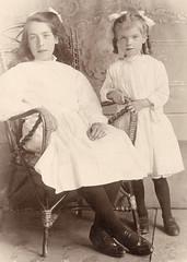 Two Girls in Black Stockings (pepandtim) Tags: postcard 54tgbs93 sisters percylandon watford 1874 aylesbury 1903 1957 hemelhempstead uk blackstockings ribbons curls bucks buckinghamshire herts hertfordshire ribbon hair edwardian studio portrait