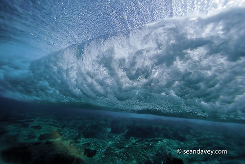 An under water view of a wave rolling across the reef at Rockpile, on the north shore of Oahu, Hawaii.