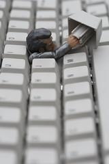 Escape (wout.) Tags: man face canon keys grey office pc keyboard doll break escape lock lol stock prison crime hiding multimedia efs60mm cybercrime eos400d