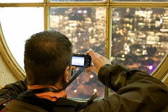 The City From The Tower (Jeremy Brooks) Tags: sanfrancisco california ca camera city window night person lights photographer unitedstates meta coittower northbeach photowalk photowalking hakandahlstrom photowalk20091104 photowalking110409