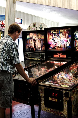 Mark playing a Playboy pinball machine.