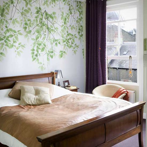 Lovely bedroom: Modern leaf wallpaper + neutral linens + sleigh bed